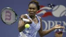 Venus Williams hits a forehand return against Irina