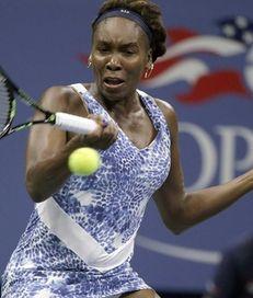 Venus Williams hits a forehand return against Irina