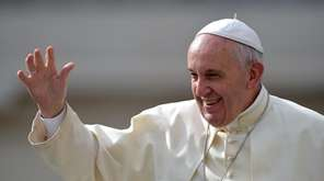Pope Francis waves as arrives in Saint Peter's