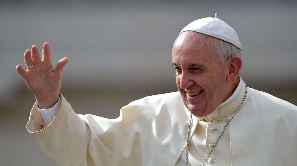 Pope Francis waves as he arrives in Saint