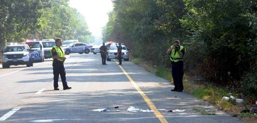 Officers investigate scene of a serious morning rush-hour