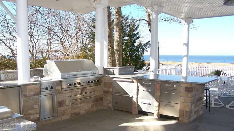 Among the homes with outdoor kitchens is this