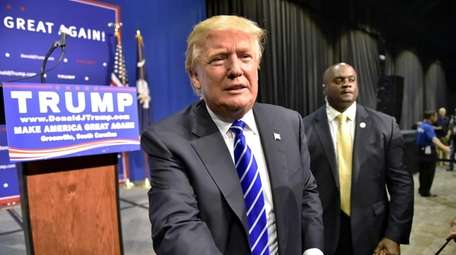 Republican presidential candidate Donald Trump greets supporters at