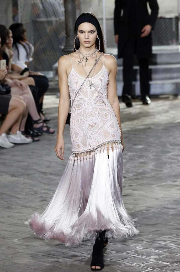 Kendall Jenner presents a creation by Givenchy in