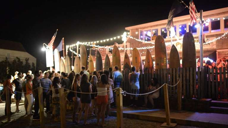 Montauk revelers wait quietly in a long line