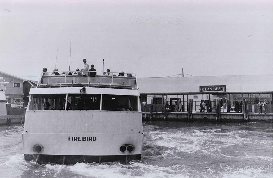 A ferry arrives at Ocean Beach, Fire Island,