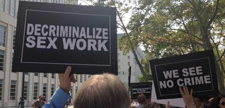 Demonstrators hold signs Thursday, Sept. 3, 2015, as