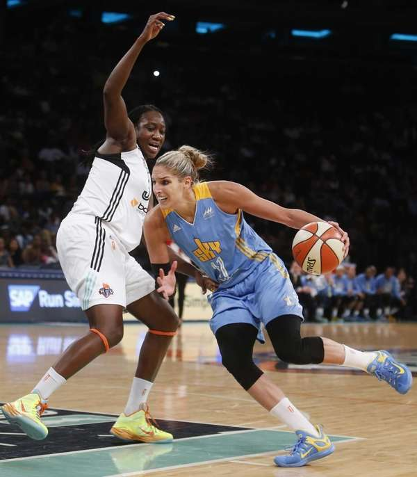 Chicago Sky's Elena Delle Donne drives against New