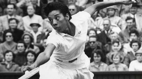Althea Gibson of the United States plays during