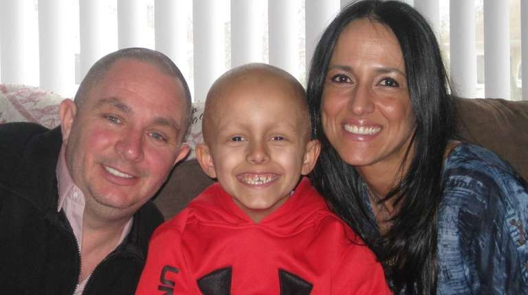 Nicholas Pedone, 7, with his parents, Nick and