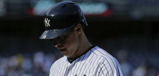 New York Yankees first baseman Mark Teixeira reacts