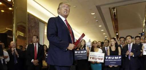 Republican presidential candidate Donald Trump walks to the