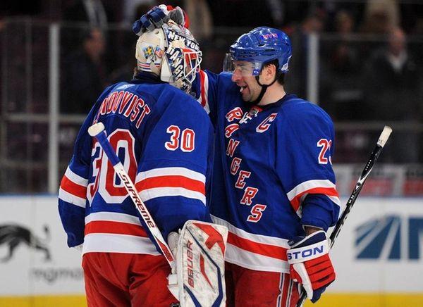 Chris Drury, right, congratulates Henrik Lundqvist after a