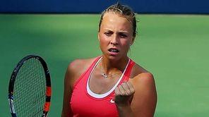 Anett Kontaveit of Estonia reacts against Madison Brengle
