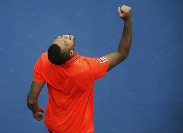 Jo-Wilfried Tsonga, of France, reacts after beating Sergiy
