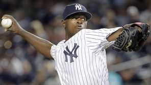 New York Yankees starting pitcher Luis Severino throws