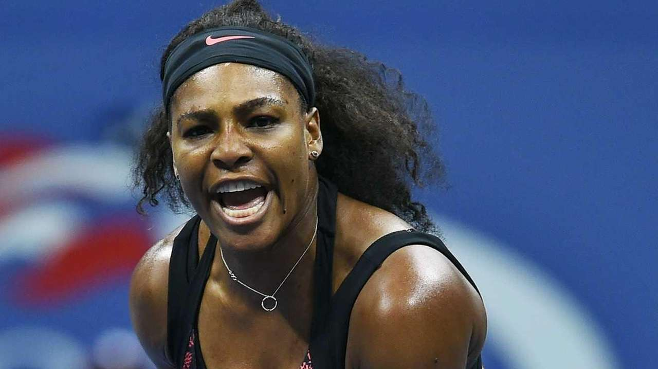 Serena Williams reacts after winning a point against