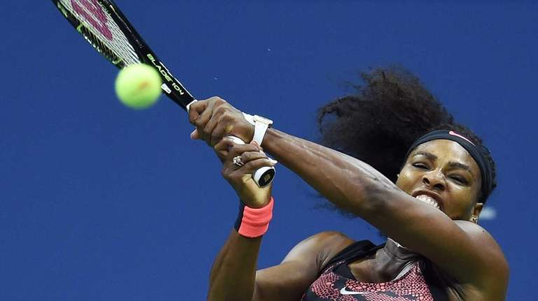 Serena Williams of the US returns the ball