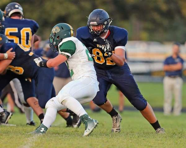 Shoreham-Wading River defensive end Ethan Wiederkehr takes down