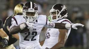 Fordham running back Chase Edmonds runs from Army