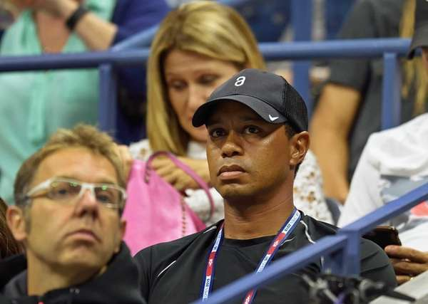 Tiger Woods watches the match between Rafael Nadal