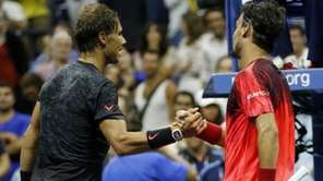 Rafael Nadal, left, of Spain, shakes hands with