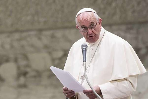 Pope Francis speaks during an audience in the