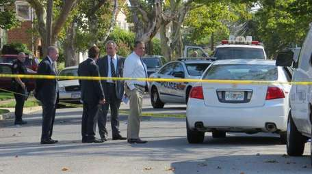 Nassau police detectives at the scene of a