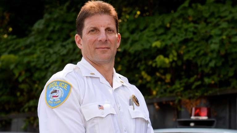 Northport Police Lt. Bill Ricca, stands next to