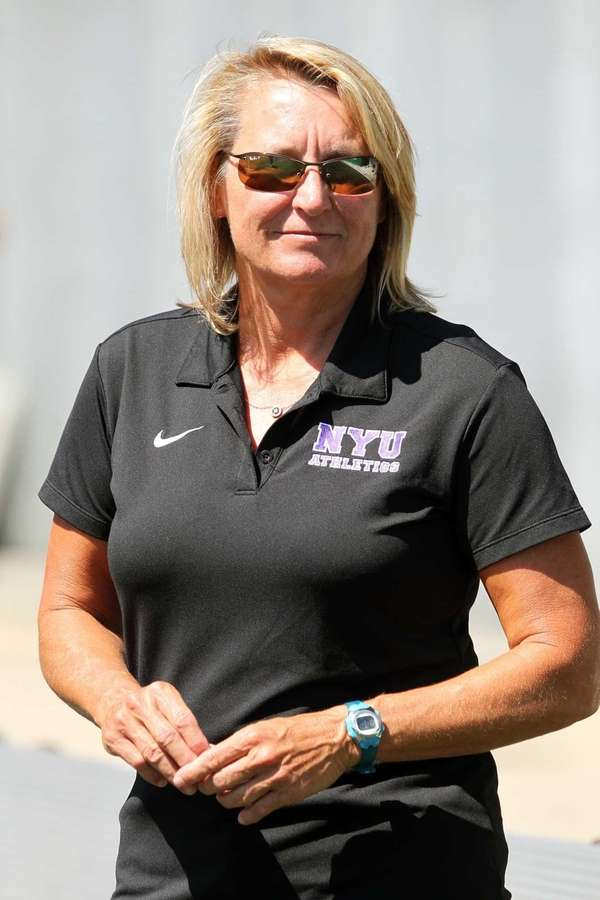 NYU men's soccer coach Kim Wyant looks on