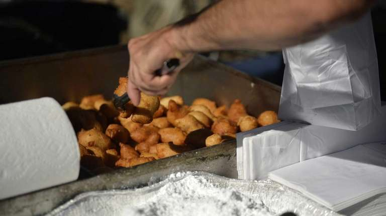 Sal Mangano of Lindenhurst prepares zeppole during the