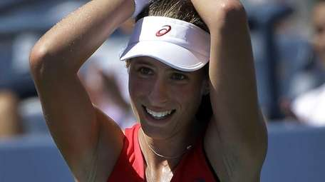 Johanna Konta reacts after beating Andrea Petkovic during