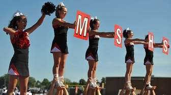 The Mount Sinai varsity cheerleading squad entertains the