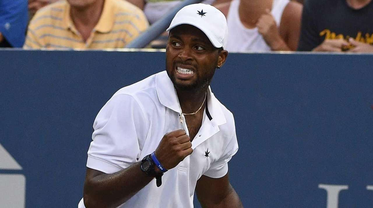 Donald Young reacts against Viktor Troicki during the