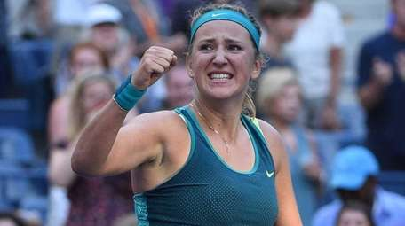 Victoria Azarenka reacts after she wins her match