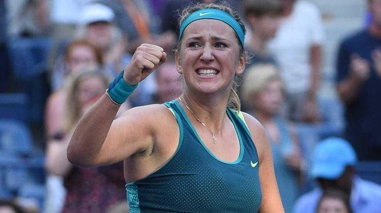 Victoria Azarenka reacts after she wins her match