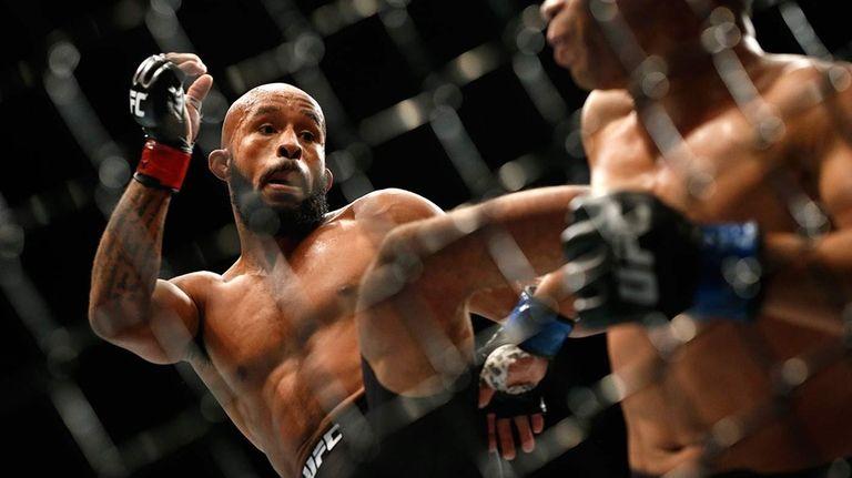 Demetrious Johnson kicks John Dodson during their flyweight