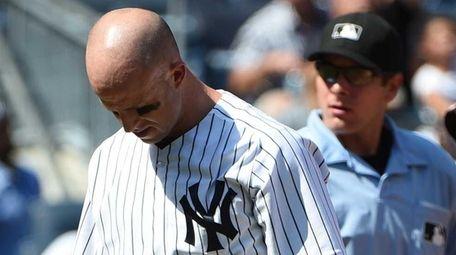 New York Yankees leftfielder Brett Gardner walks to