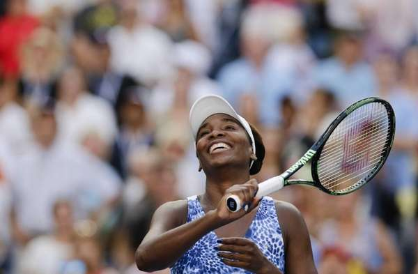 Venus Williams smiles broadly after beating Anett Kontaveit
