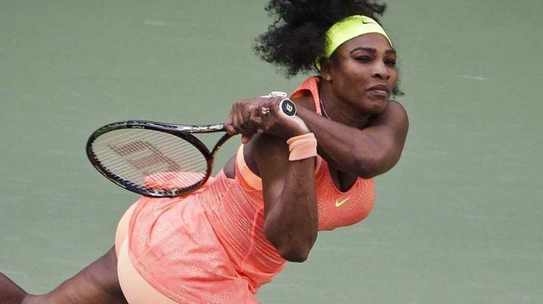 Serena Williams returns a shot to Madison Keys