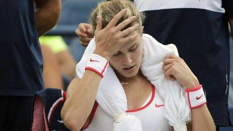 Eugenie Bouchard takes a break between games against