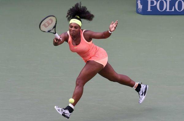 Serena Williams returns the ball to Madison Keys