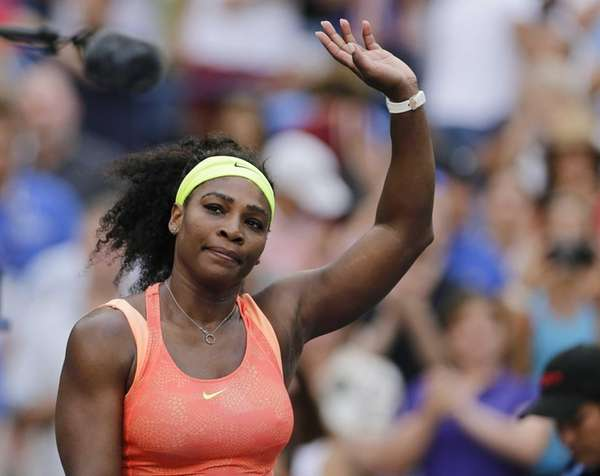 Serena Williams, of the United States, waves to