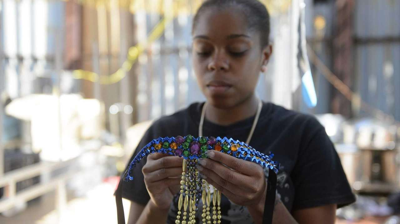 Magdelayna Govan prepares costumes in a Brooklyn lot