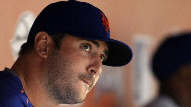 New York Mets pitcher Matt Harvey watches play