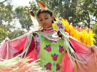 A Native American dancer performs at the Shinnecock