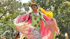 An American Indian dancer performs at the Shinnecock