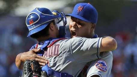 New York Mets catcher Travis d'Arnaud celebrates with