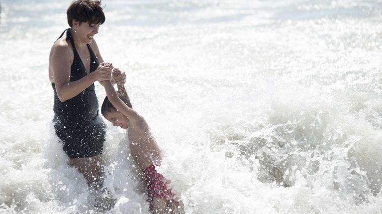 Beach goers enjoy the last days of summer