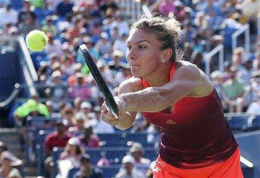 Simona Halep, of Romania, returns a shot to